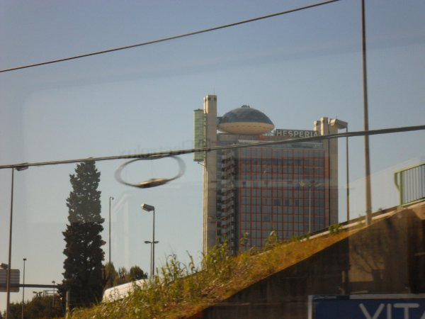 Nearing the outskirts of Barcelona the landscape morphs from countryside to high rise buildings. This one has an escape UFO on the roof.
