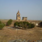 The belfry and clock tower viewed from the west wall of the castle in Mourão, Alentejo, Portugal